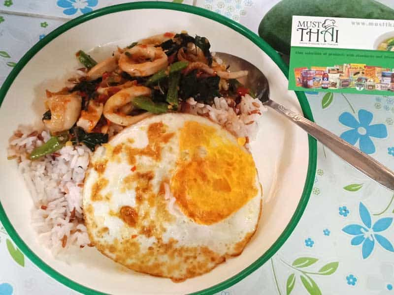Hot basil stir fried with squid with a fried egg