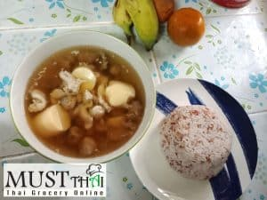 Fried garlic soup with straw mushroom chicken and egg tofu