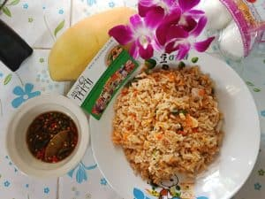 Fried rice with salted egg by Thai home cooking. Vegetarian meal with egg.