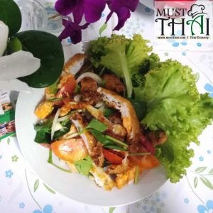 Spicy salad with fried eggs
