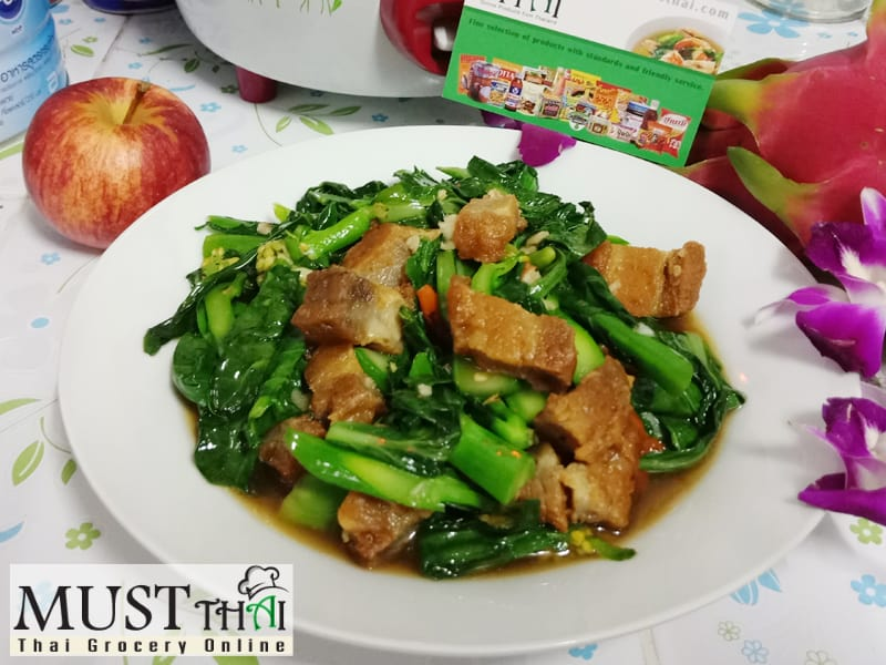 Stir fried Chinese kale with crispy pork